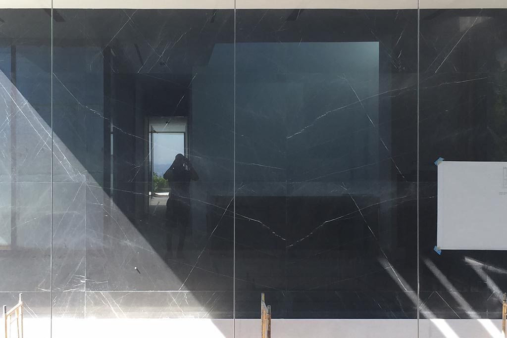 Fashion designer's residence renovation - existing black granite tiles on exterior walls